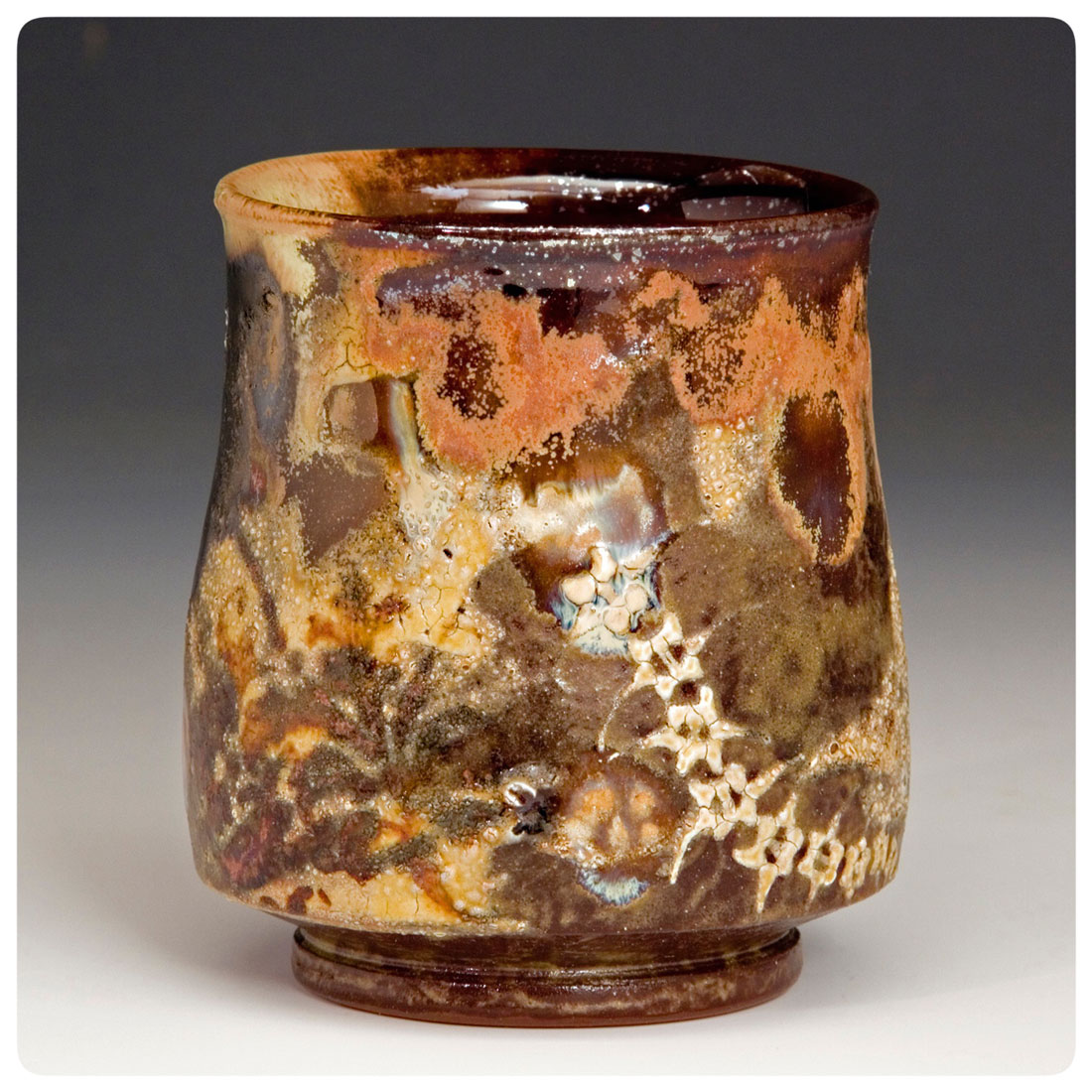 Cup-with-bone-decoration-and-crackle-slip-made-by-Bruce-Gholson.jpg