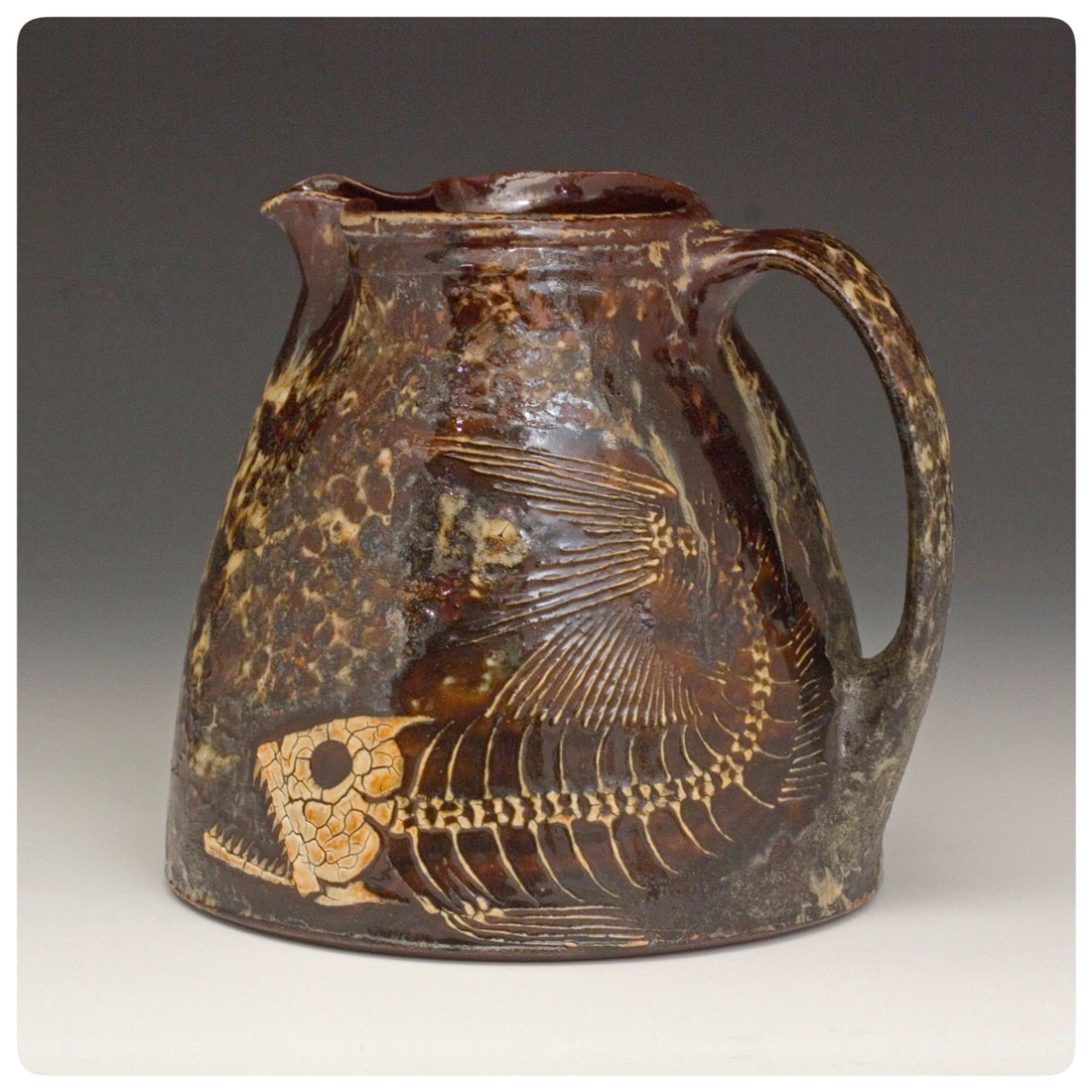 Pitcher-with-hand-drawn-fossil-fish-and-crystalline-glazes-made-by-Bruce-Gholson.jpg