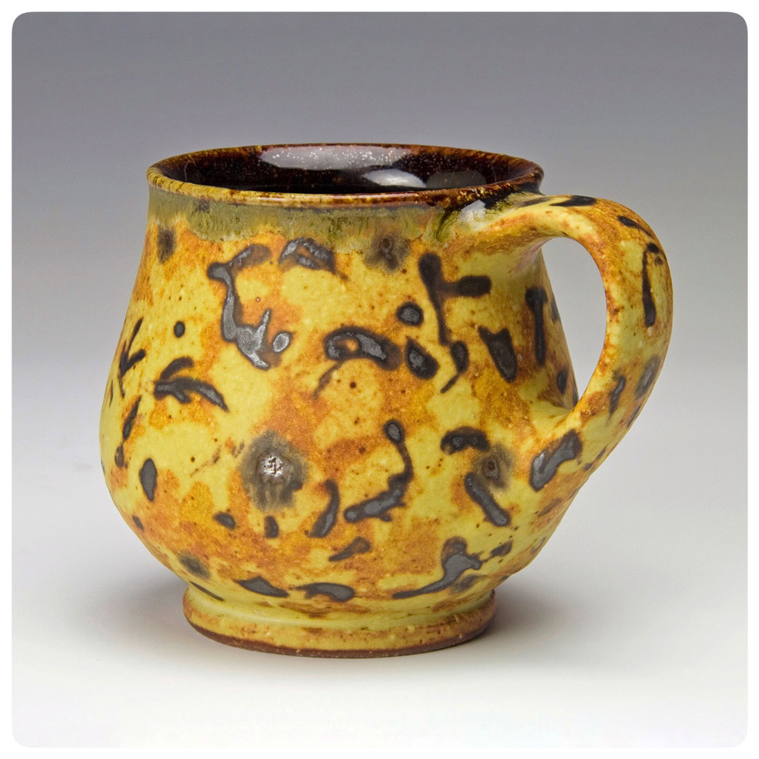 Studio-Pottery-Mug-with-decoration-made-by-Bruce-Gholson.jpg