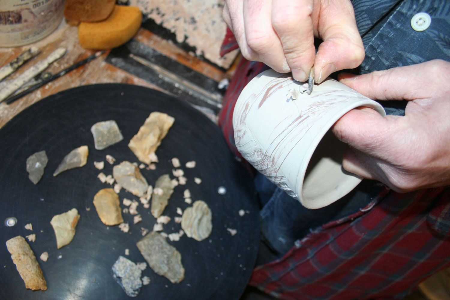 Bruce carving one of his cups with a blade of a broken arrowhead | Bulldog Pottery | Seagrove | North Carolina