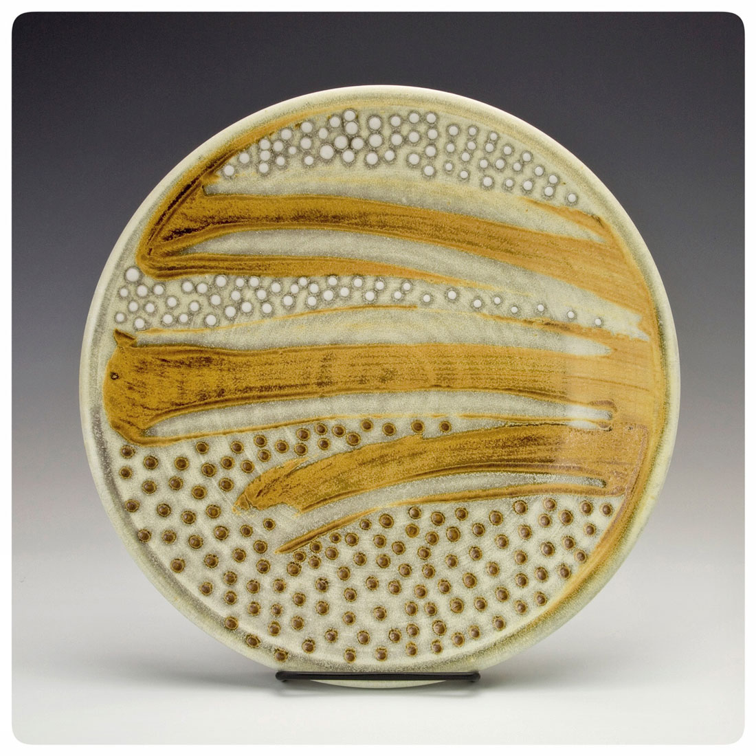 Plate with wide bands and dot pattern made by Samantha Henneke | Bulldog Pottery | Seagrove | North Carolina