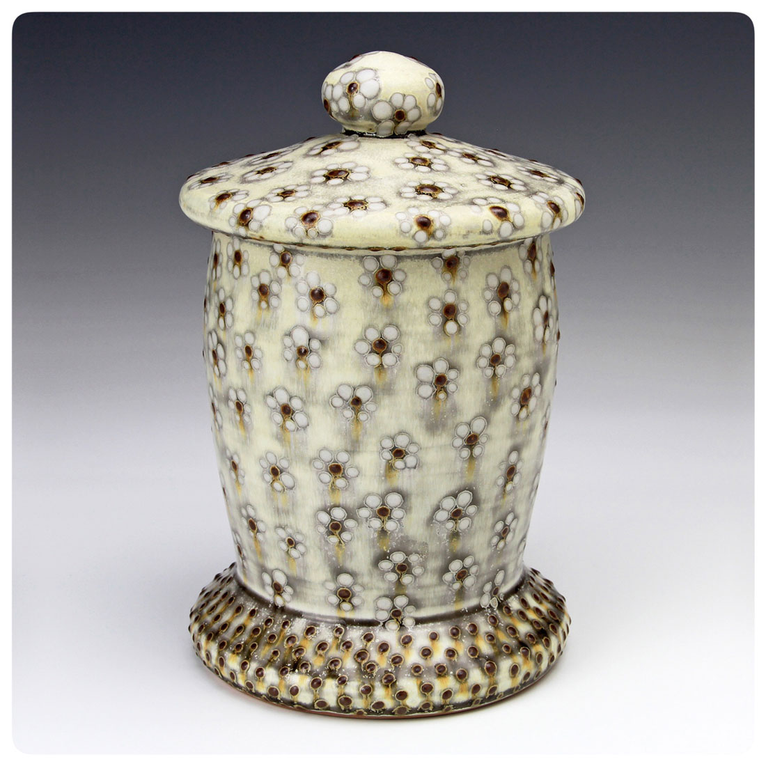 Covered Jar with white flower dot pattern made by Samantha Henneke | Bulldog Pottery | Seagrove | North Carolina