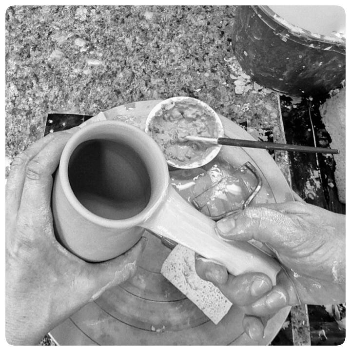Samantha Henneke Pulling a Handle in the Studio| Bulldog Pottery | Seagrove | North Carolina