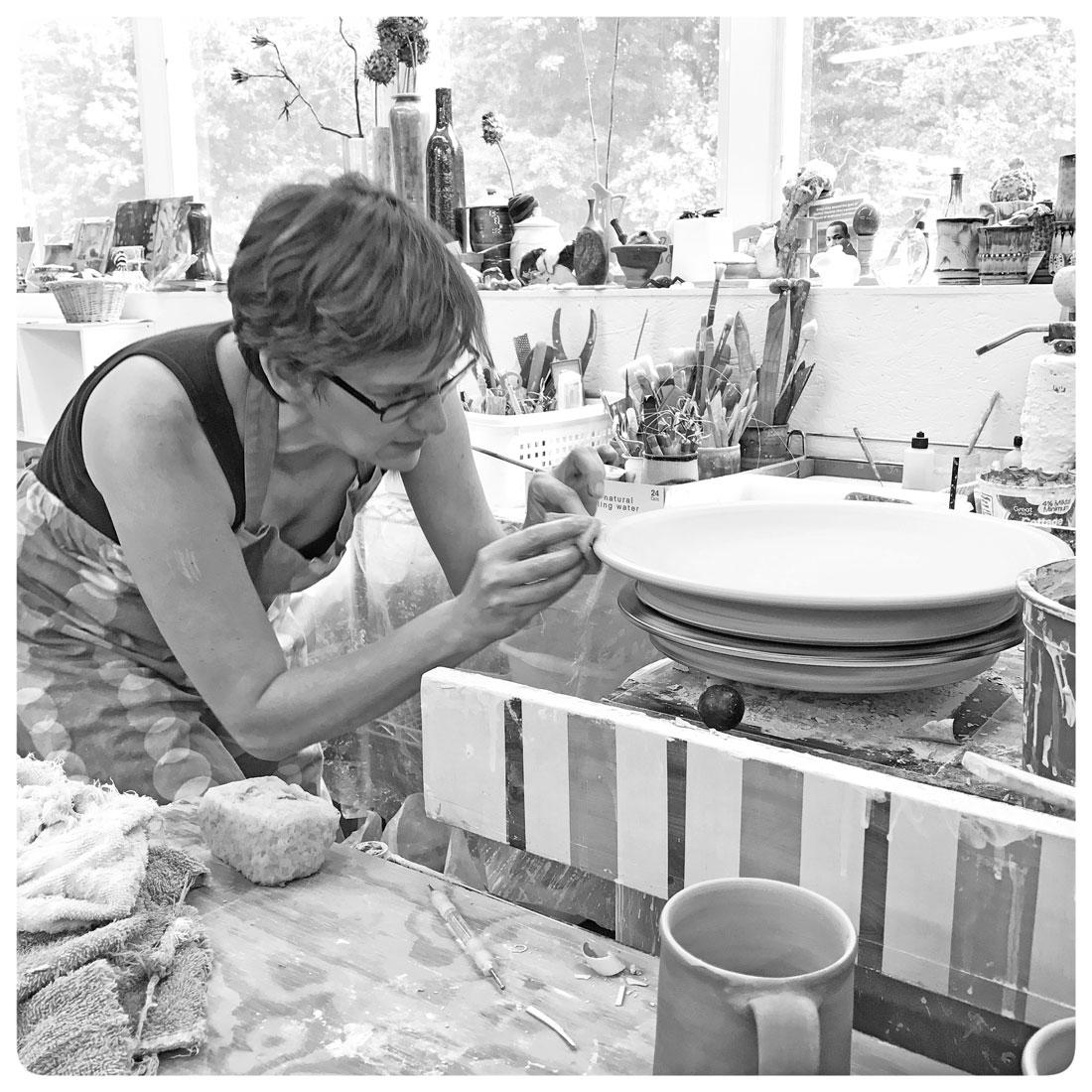 Samantha finishing the rim of a platter | Bulldog Pottery | Seagrove | North Carolina