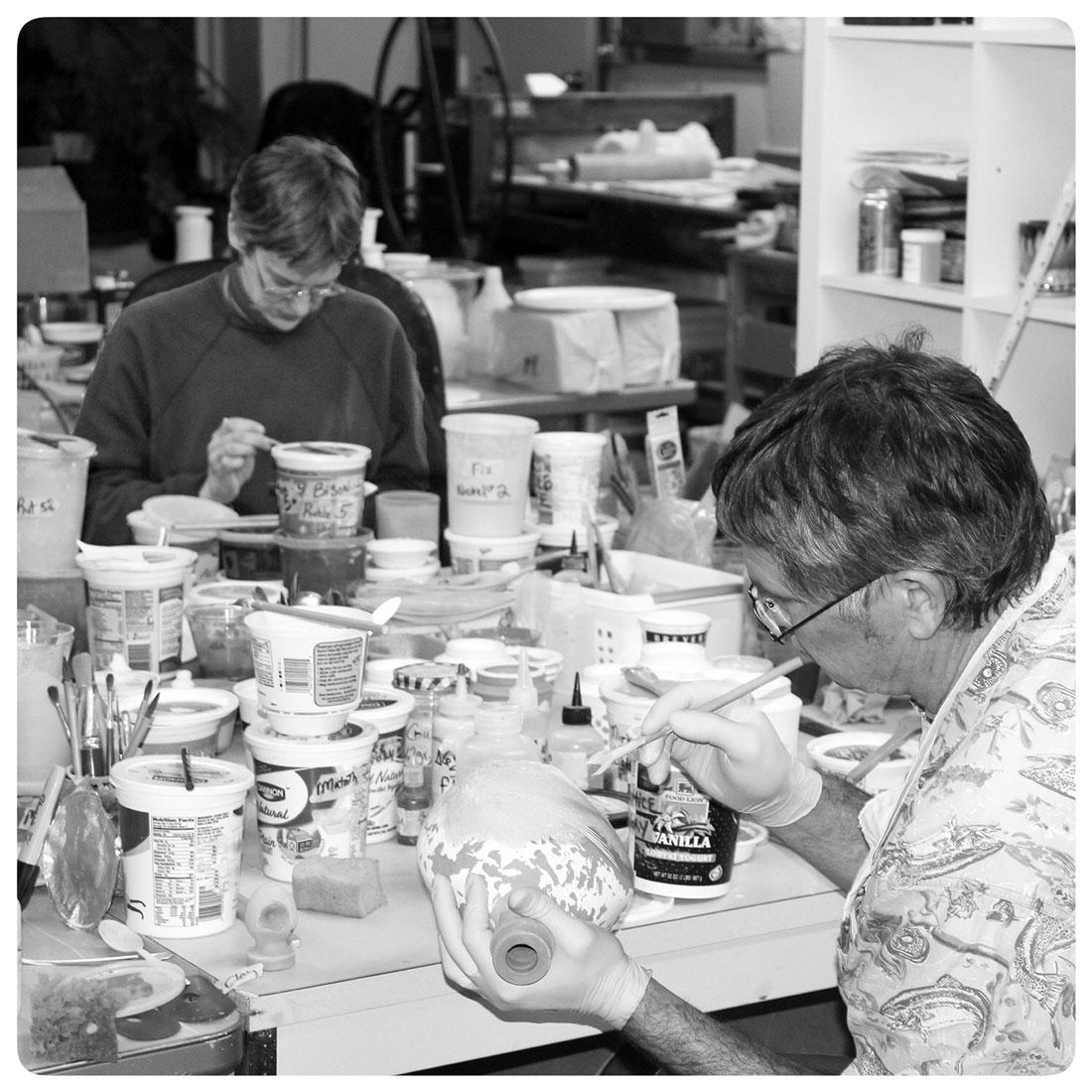 Bruce-Gholson-and-Samantha-Henneke-glazing-in-the-Pottery-Art-Studio.jpg