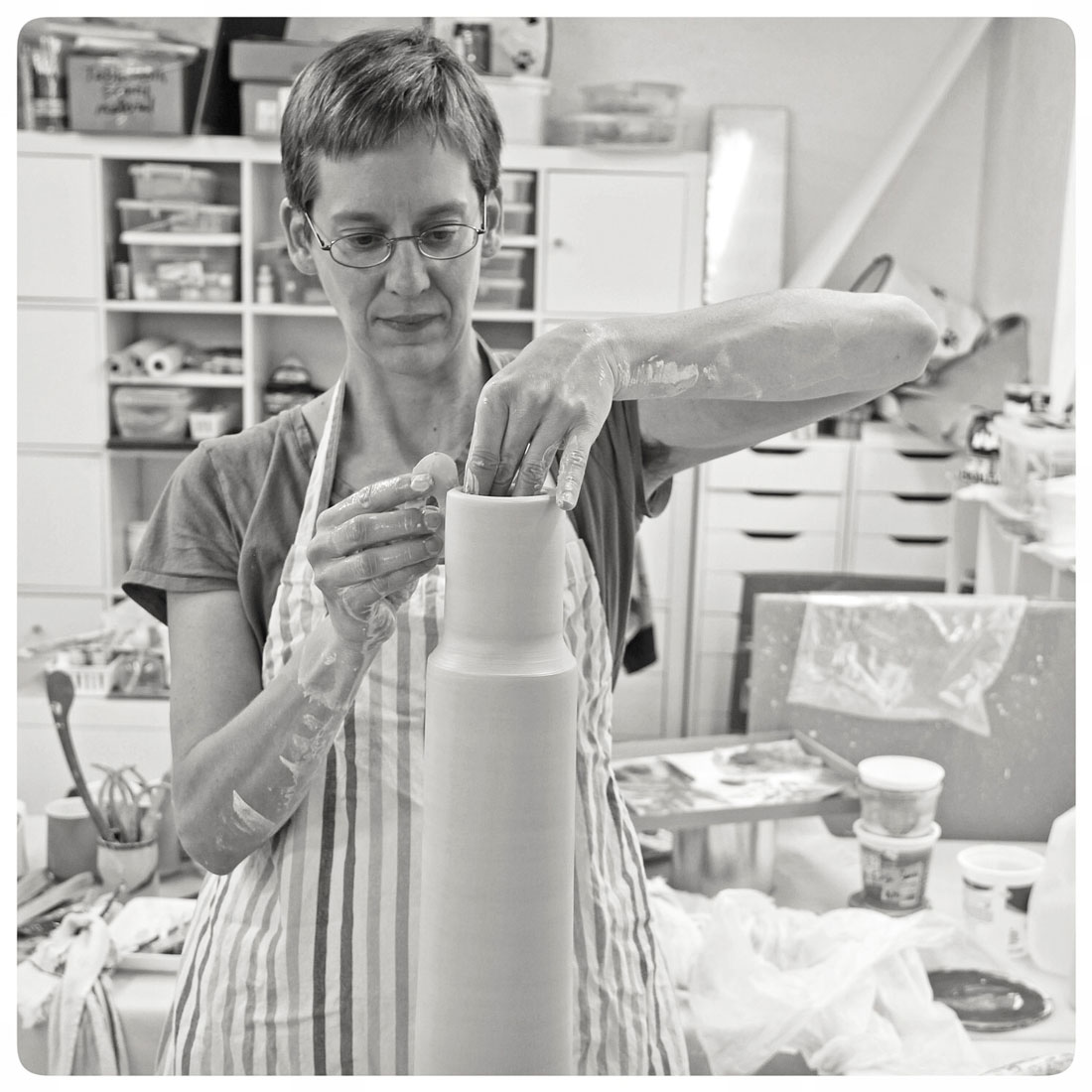 Samantha-Henneke-working-on-a-tall-vase-at-the-potters-wheel.jpg