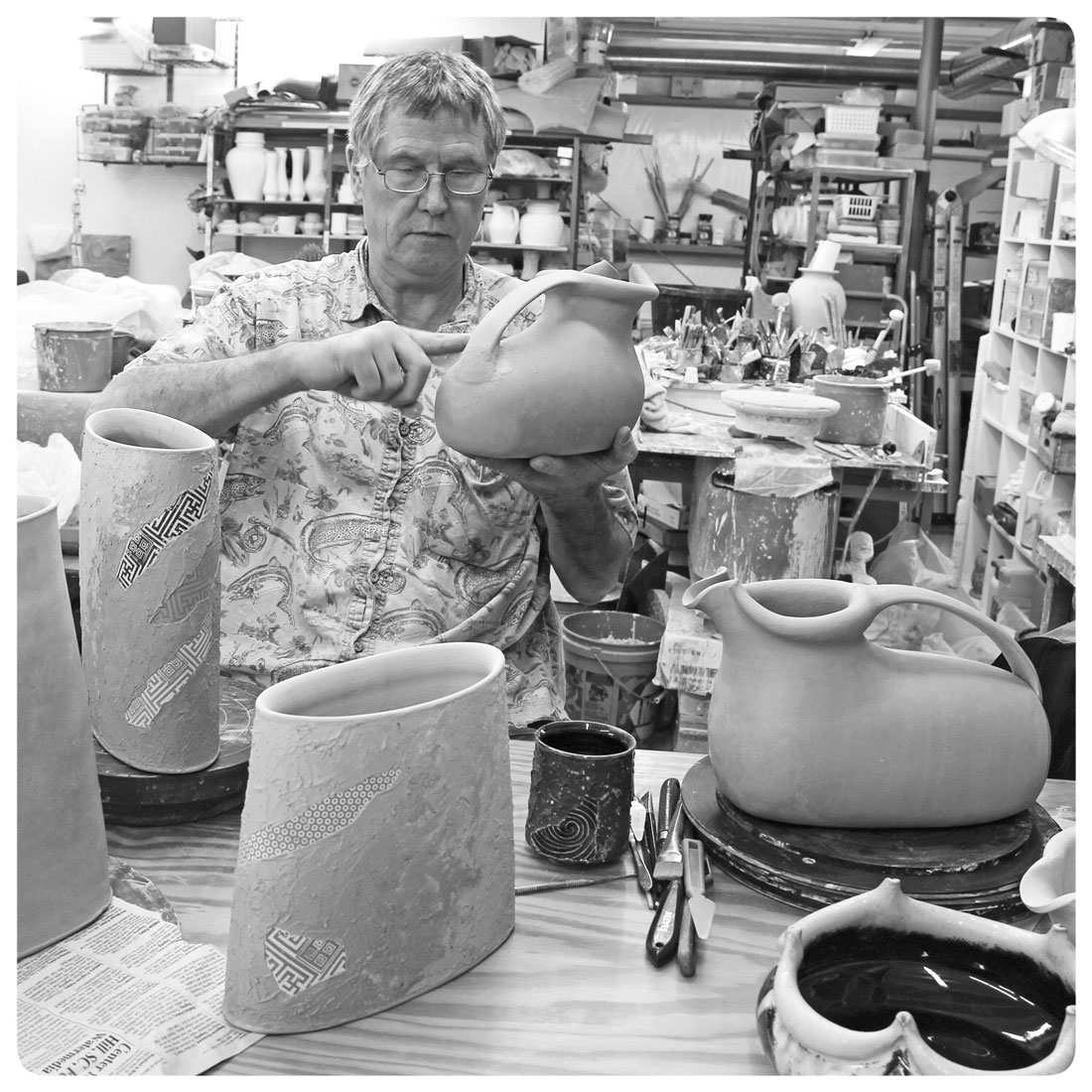 Bruce-Gholson-working-on-one-of-his-barrel-pitchers.jpg