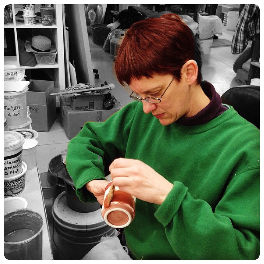 Samantha Henneke glazing a cup in the Bulldog Pottery studio in Seagrove, North Carolina