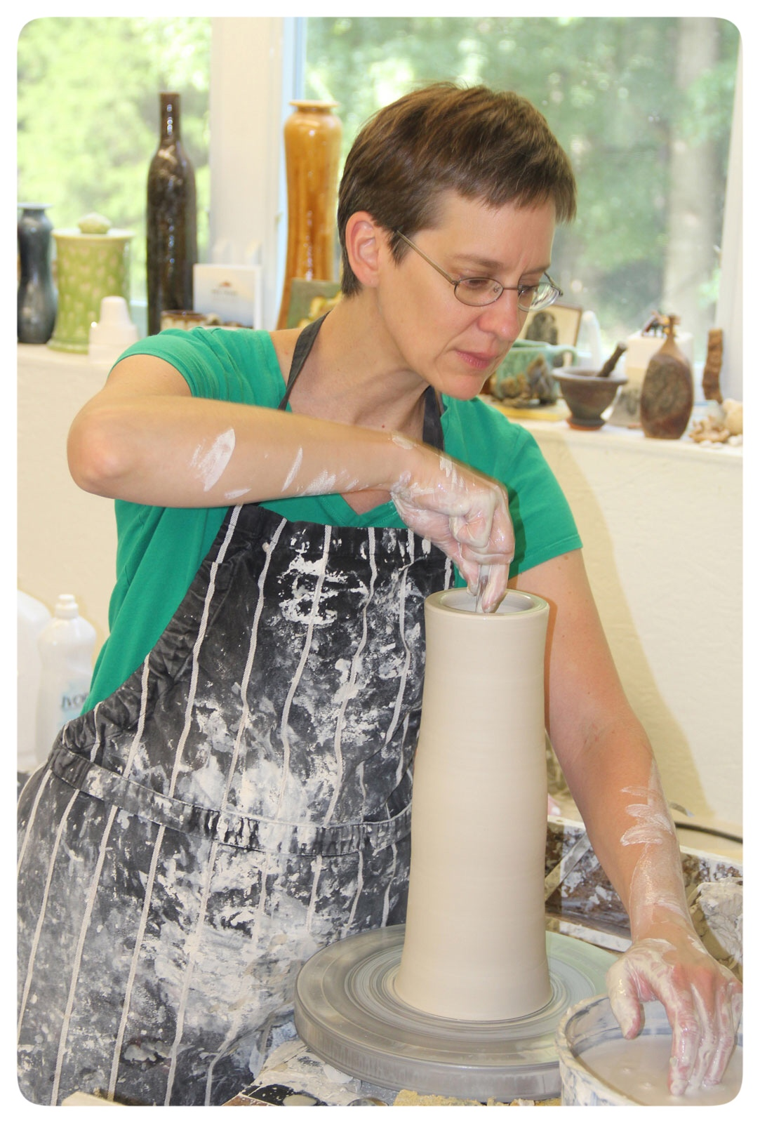 Samantha Henneke throwing at the wheel in the Bulldog Pottery Studio in Seagrove North Carolina