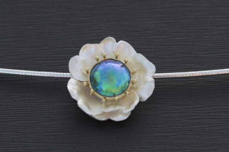 The Empowerment Pearl with Eyris Gem grade blue green pearl