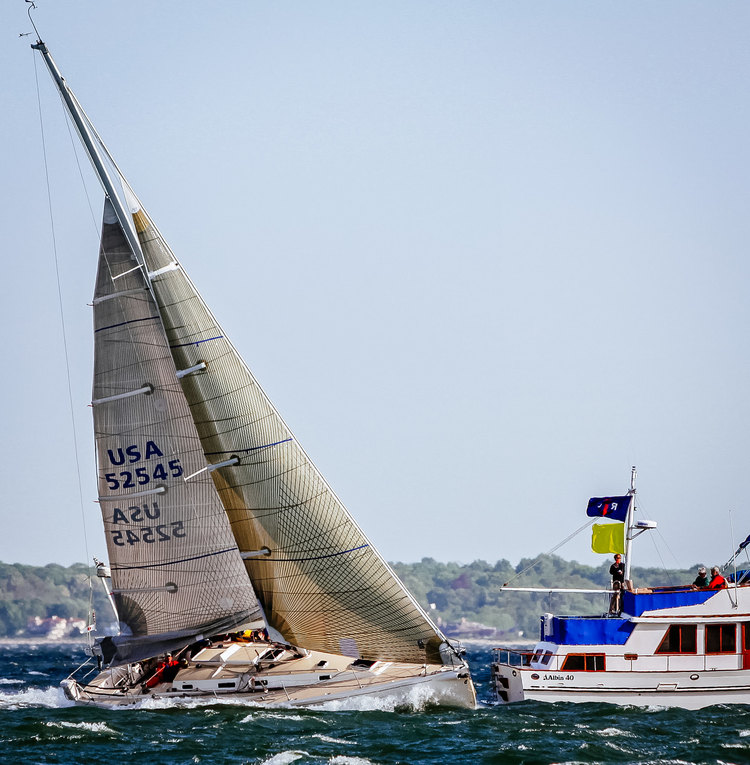 A J/133 with a double-reefed mainsail and a No. 4 genoa, which meets the ISAF requirements for a heavy weather jib.