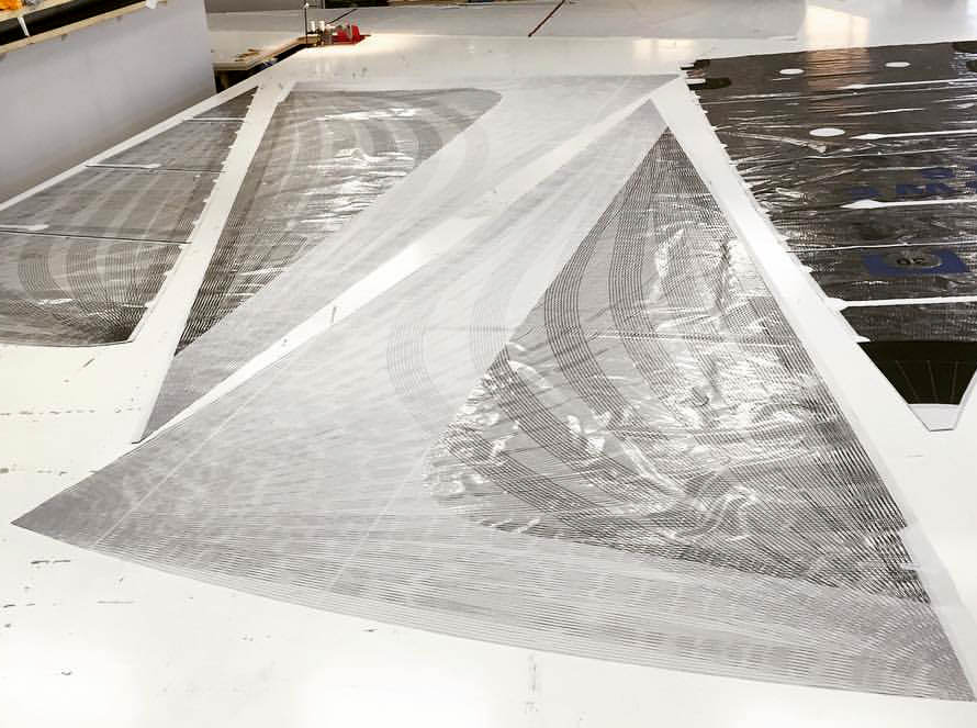Two carbon X-Drive genoas with a partial taffeta layer over part of the sail that overlaps the mast. This prevents the mylar over the tapes from being abraded as the sail comes in contact with the mast and shrouds during tacks.