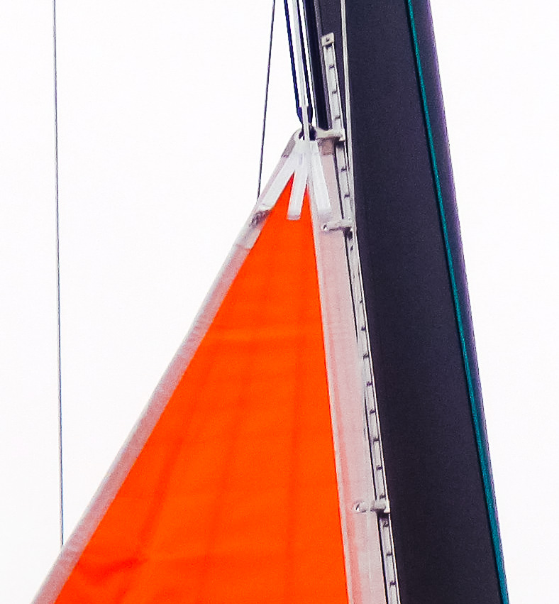 UK Sailmakers puts two slides at the head and tack of the storm trysail to spread the load at these highly loaded points. If the sail is inserted into a bolt rope track, we web on a 3-inch stainless steel slide at the head and tack.