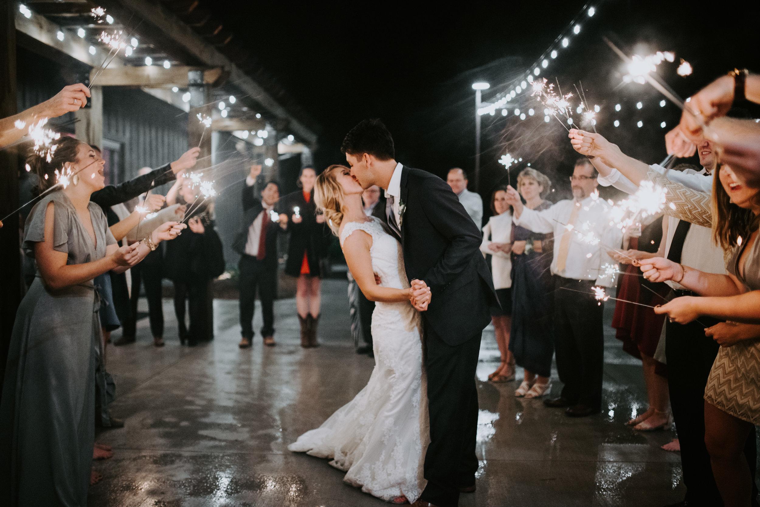 sparkler exit bride and groom kissing twinkle lights memphis wedding photographer