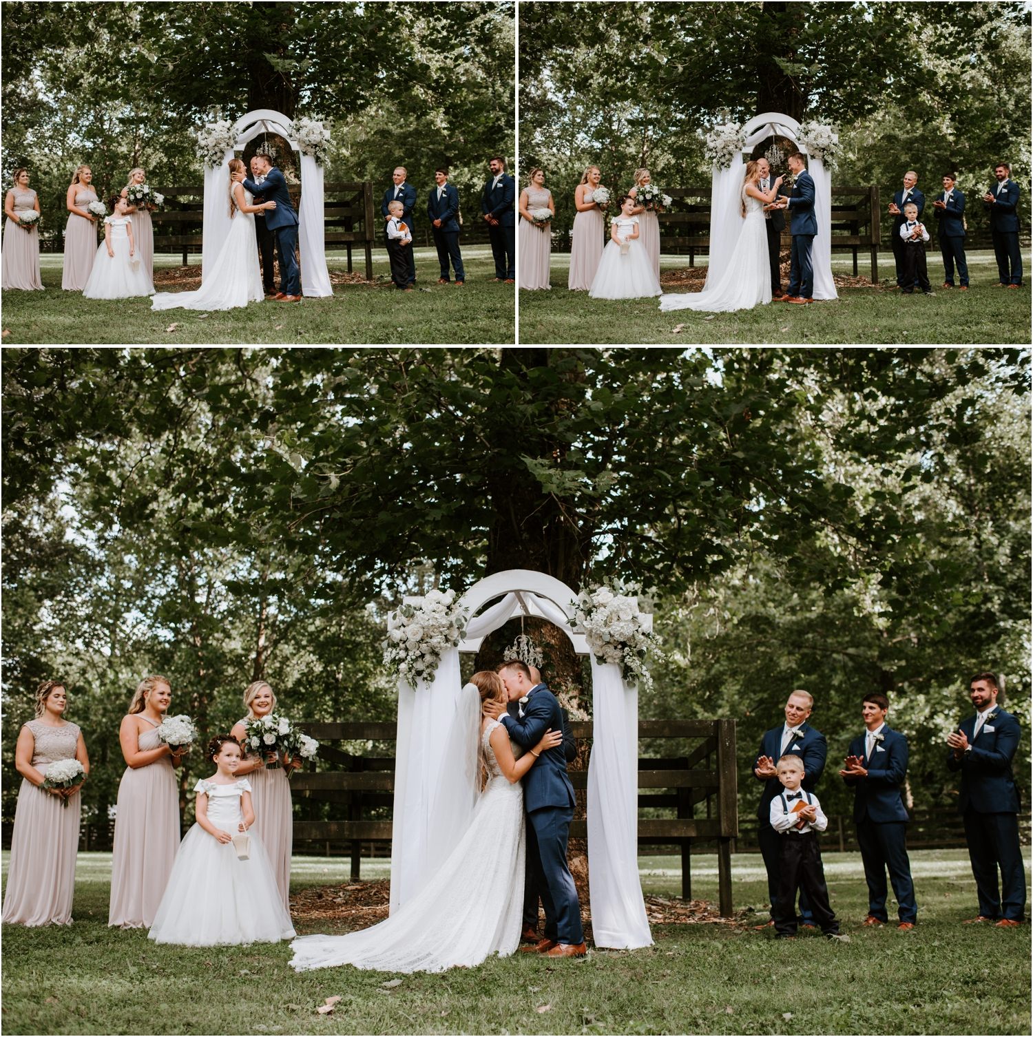 bride and groom first kiss under white arbor with floral arrangements and drapes