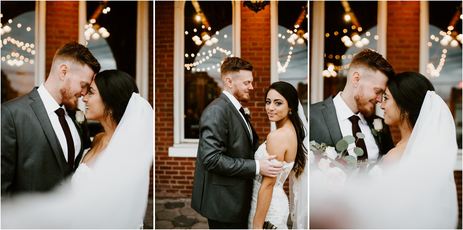 veil blowing in the wind bride and groom portrait