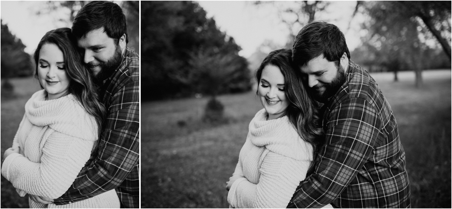 guy in flannel snuggling girl in cream sweater around waist black and white photo