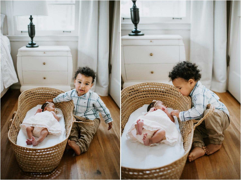 memphis newborn session baby in bassinet moses basket natural light bedroom