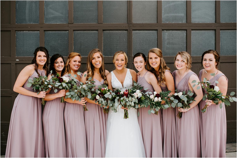 long mauve bridesmaids dresses greenery bouquets