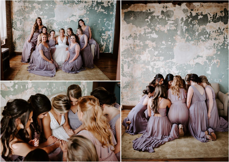 bridesmaids praying with bride at wedding