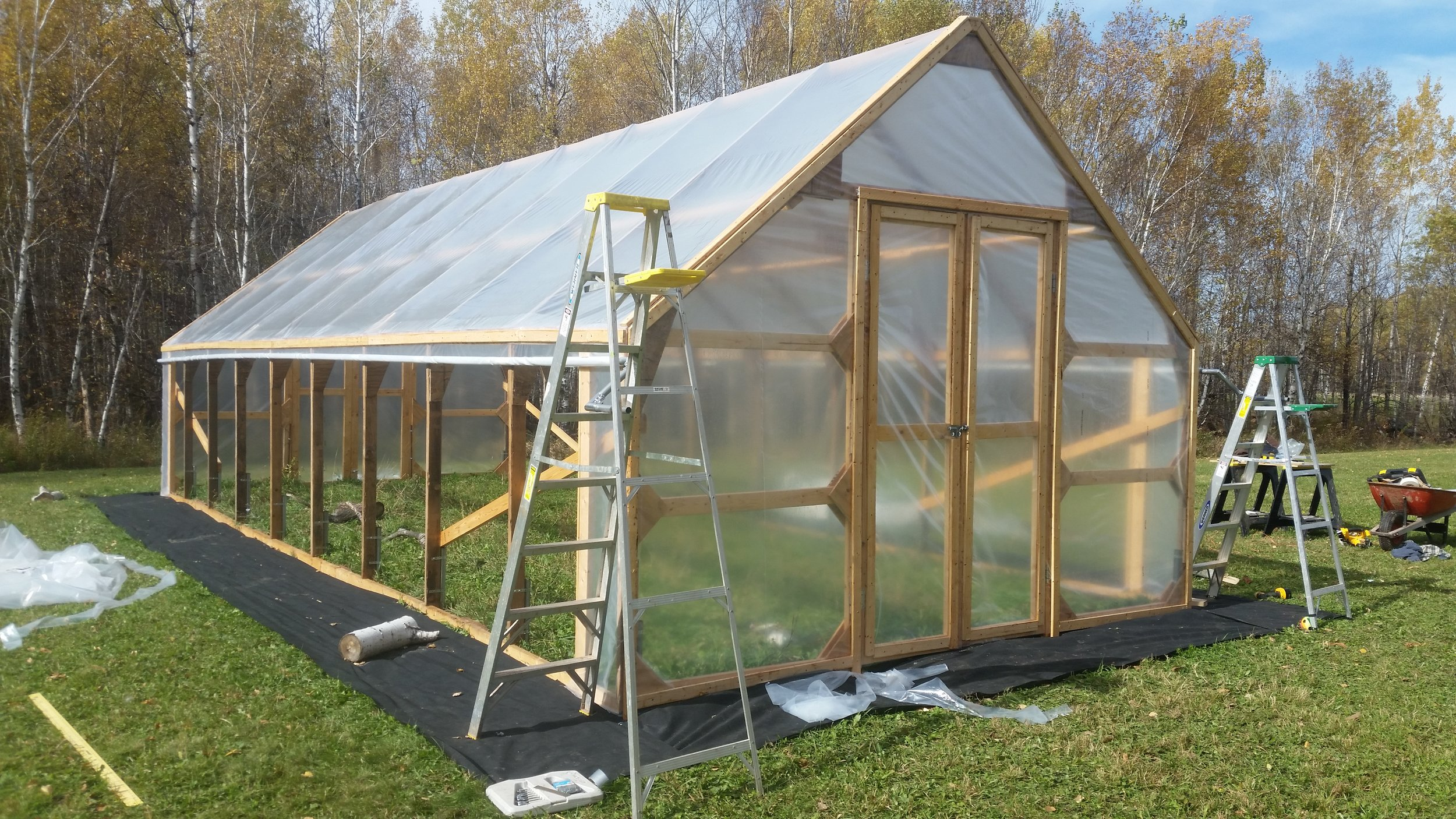 Putting the finishing touches on the hoophouse
