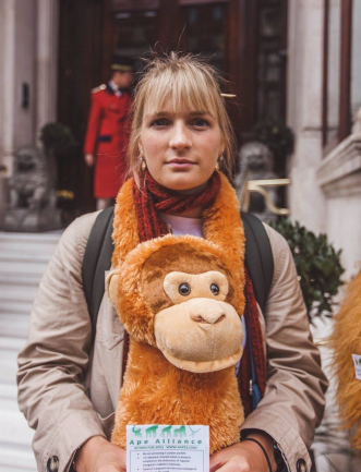 Image 4: Orangutan Alliance UK Correspondent Deya Ward protesting to stop the development of the dam funded by the Bank of China, armed with the orangutan she will run the London Marathon with for Sumatran Orangutan Society. [Photo: Tory Tsui, Instagram: @torytsui]