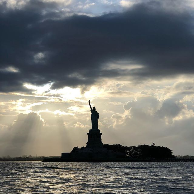 A mighty woman with a torch, whose flame is the imprisoned lightning, and her name MOTHER OF EXILES. - Emma Lazarus