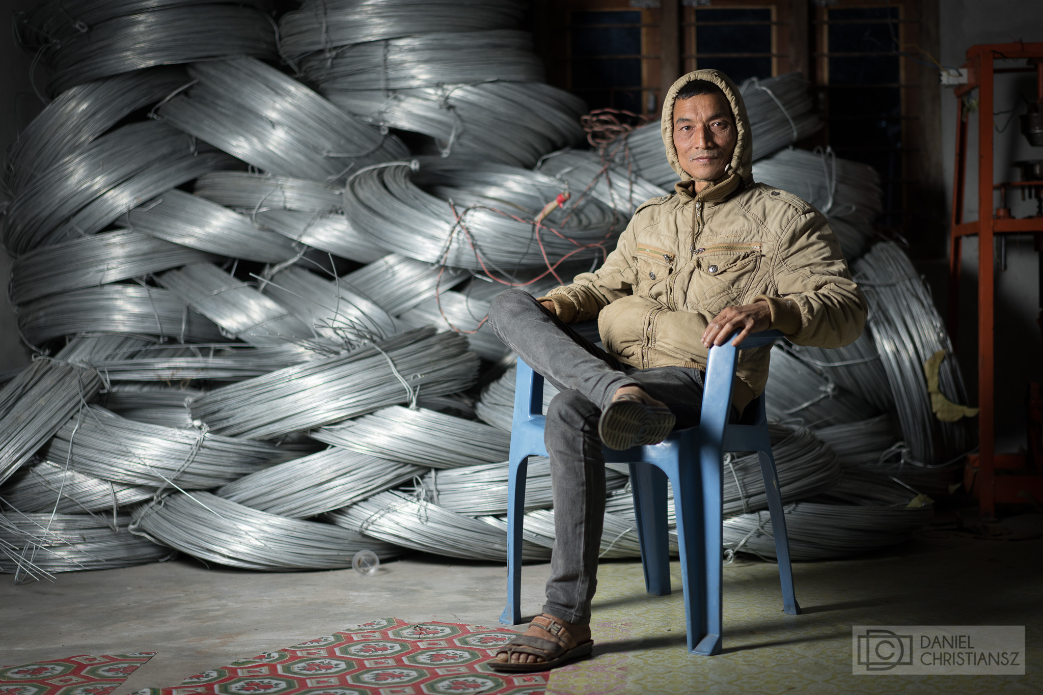 Man in Nepal Sitting on Chair