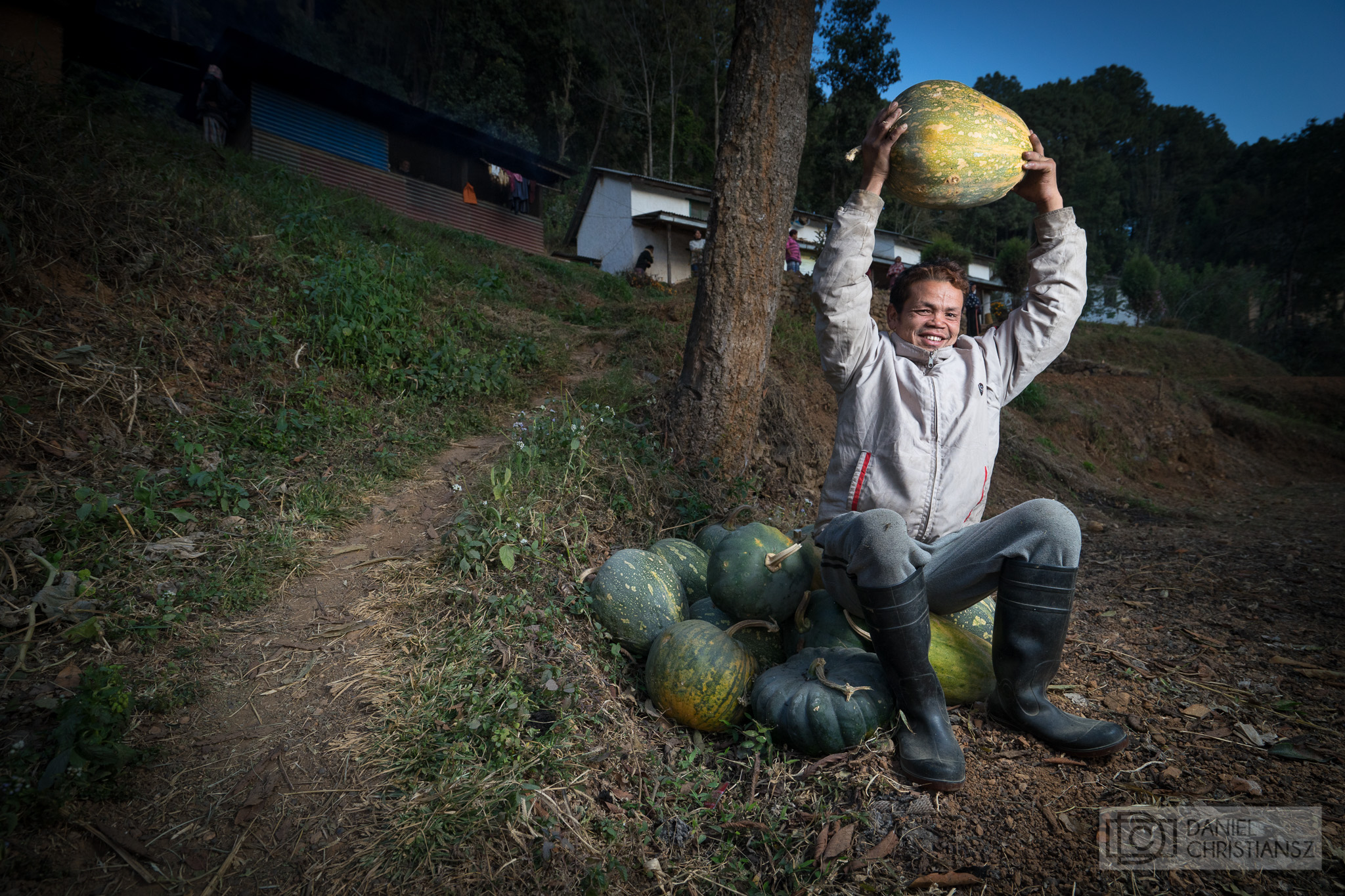 Man Holding up Watermelon