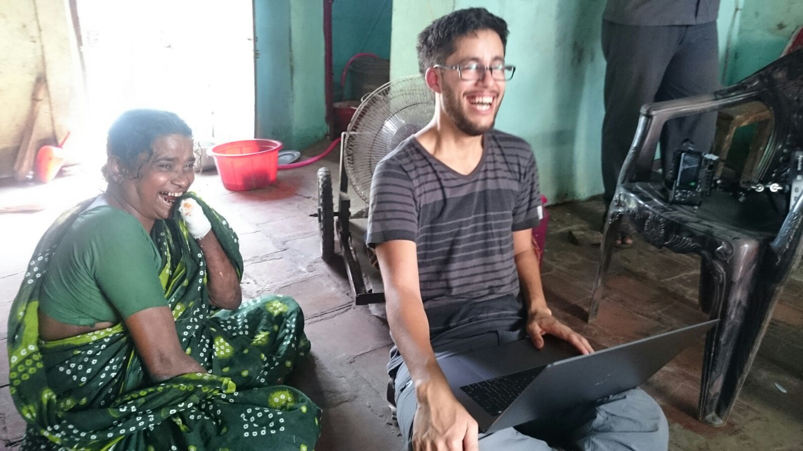Daniel Christiansz reviewing footage with Nagammal in her home in India