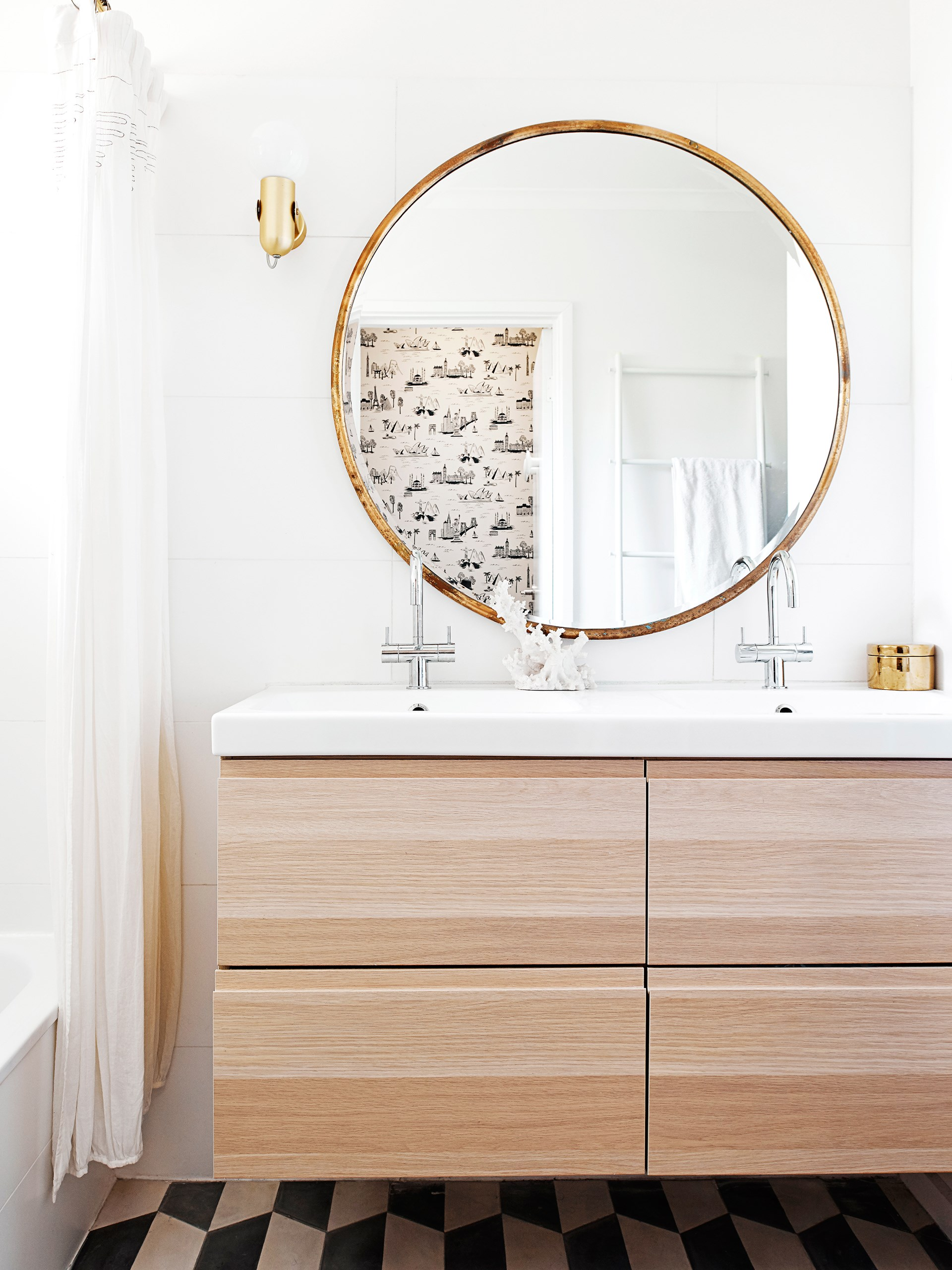 Tired of waiting for your partner to finish using the bathroom? Try a double vanity for a super stylish and practical solution.