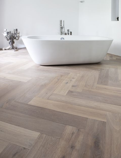 Use parquet in the bathroom for a warm and luxurious feel.