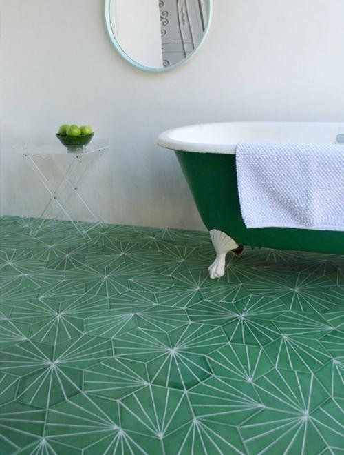 Geometric tiles look together with a free standing bath just has that WOW factor.