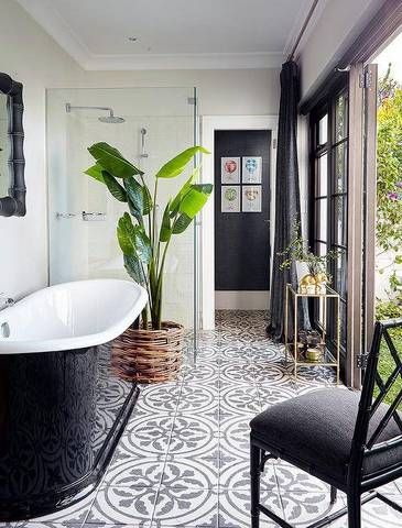 Tiles that pic up on the tones of the freestanding bath and the rest of the bathroom makes it look so chic!