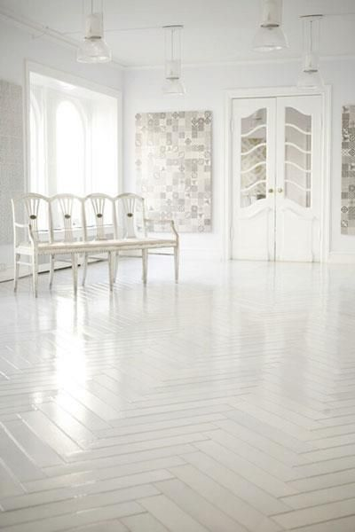 Fans of minimalist, try painting your parquet white for that ultra modern look.