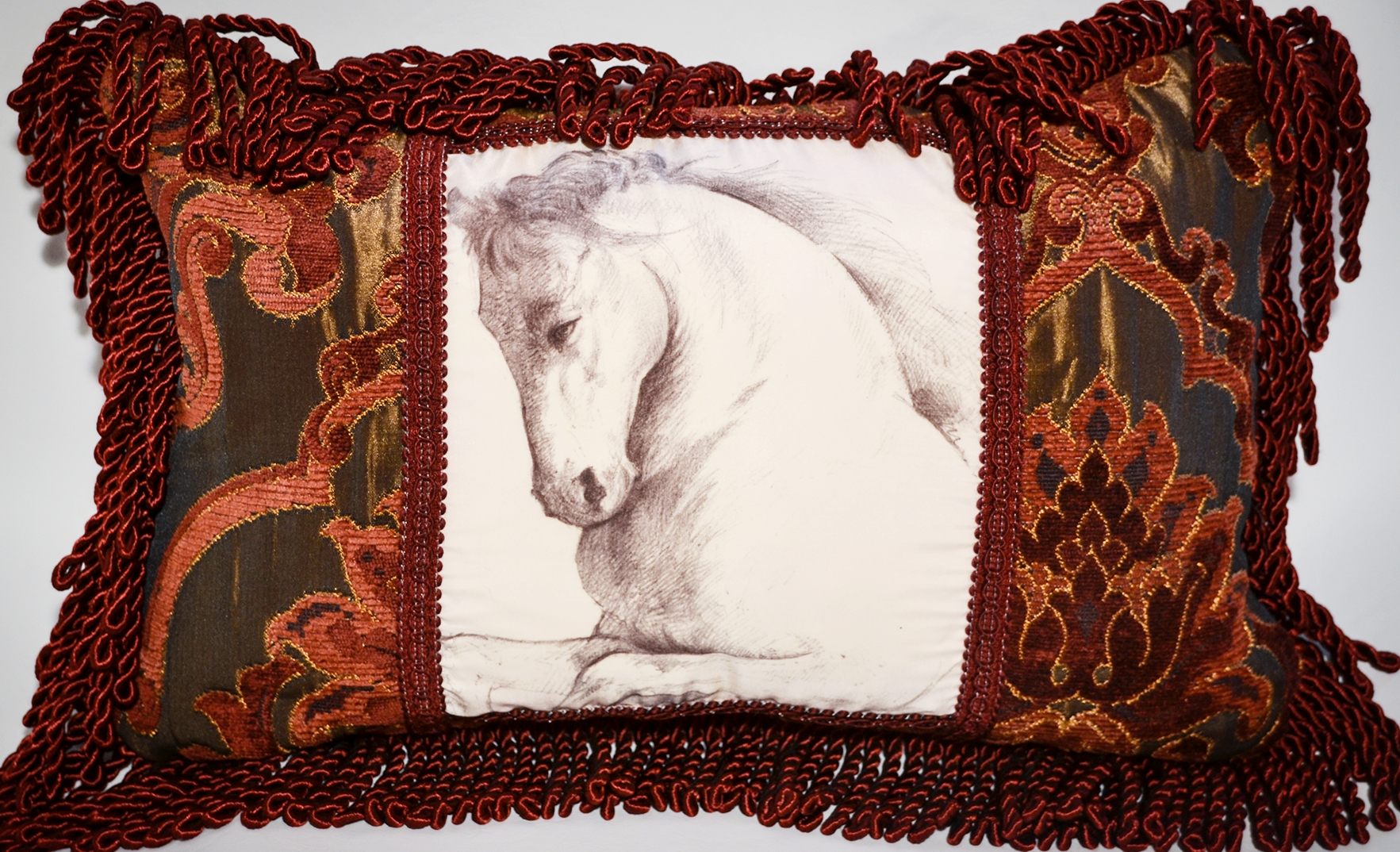 "Image of a horse printed on silk, framed in a beautiful burgundy brocade and satin fringes.  This cushion dimensions are 18"" x 12"" with down feather cushion insert."