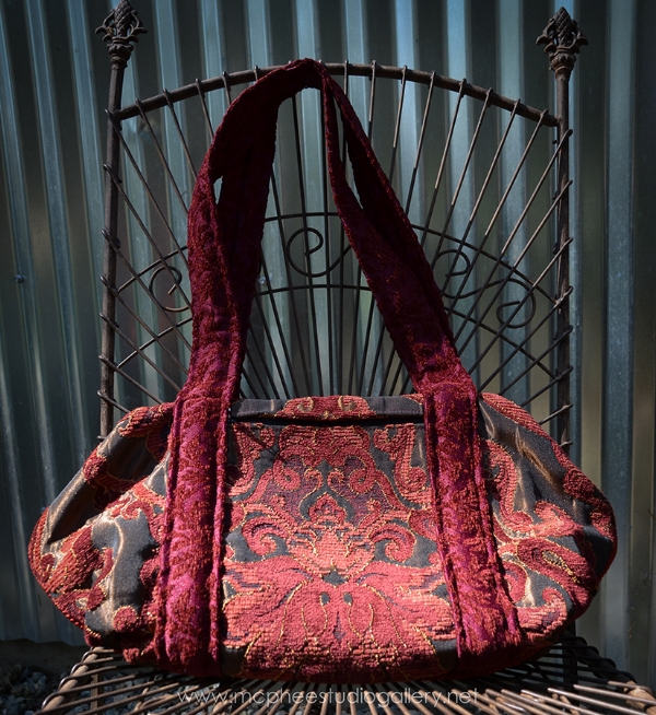 This one here is made with beautiful red brocades and velvet trims - doctor bag.