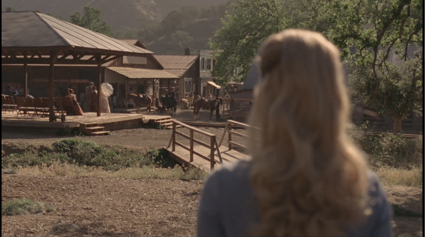Fan theories suggest that Dolores is actually remembering this town from the past, but it seems to her as if it's here in the present.