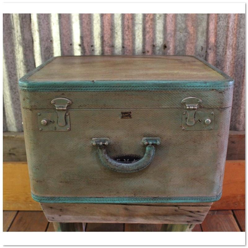 blue green suitcase.jpg