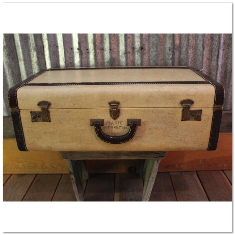 tan and black suitcase w writing.jpg