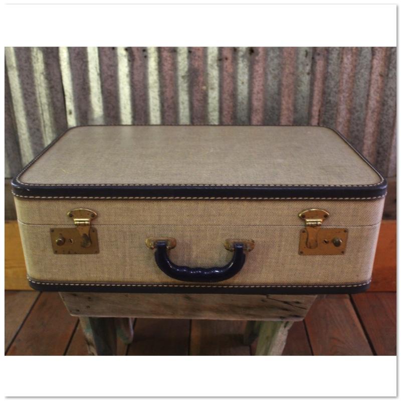 tan and black suitcase.jpg