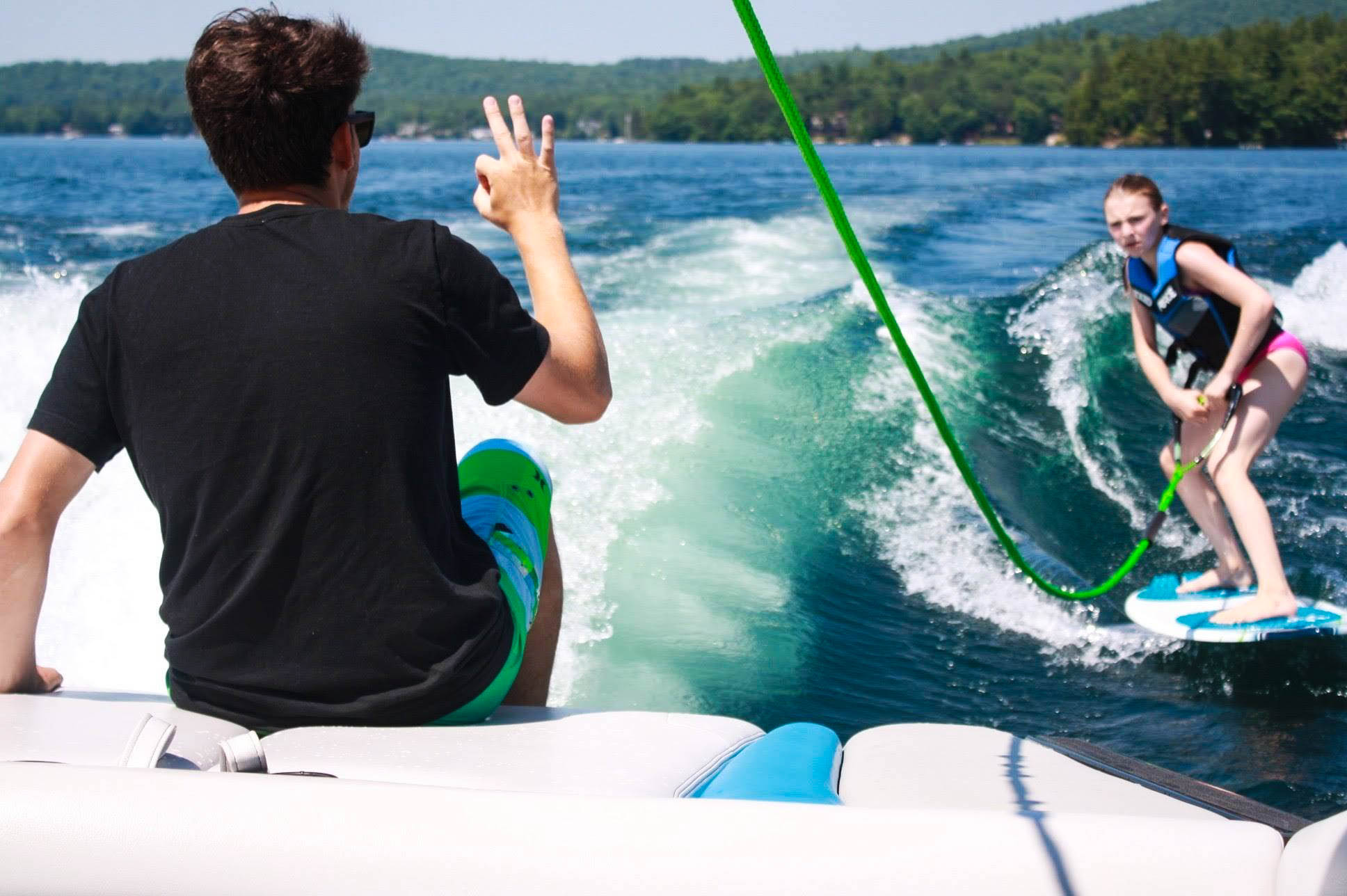 Summer camp lake instructor wakesurf