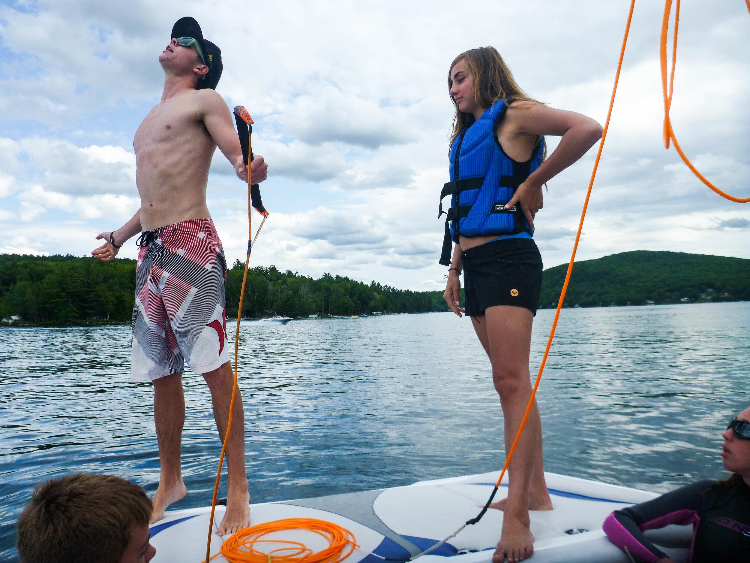 Summer camp lake instruction wakeboard