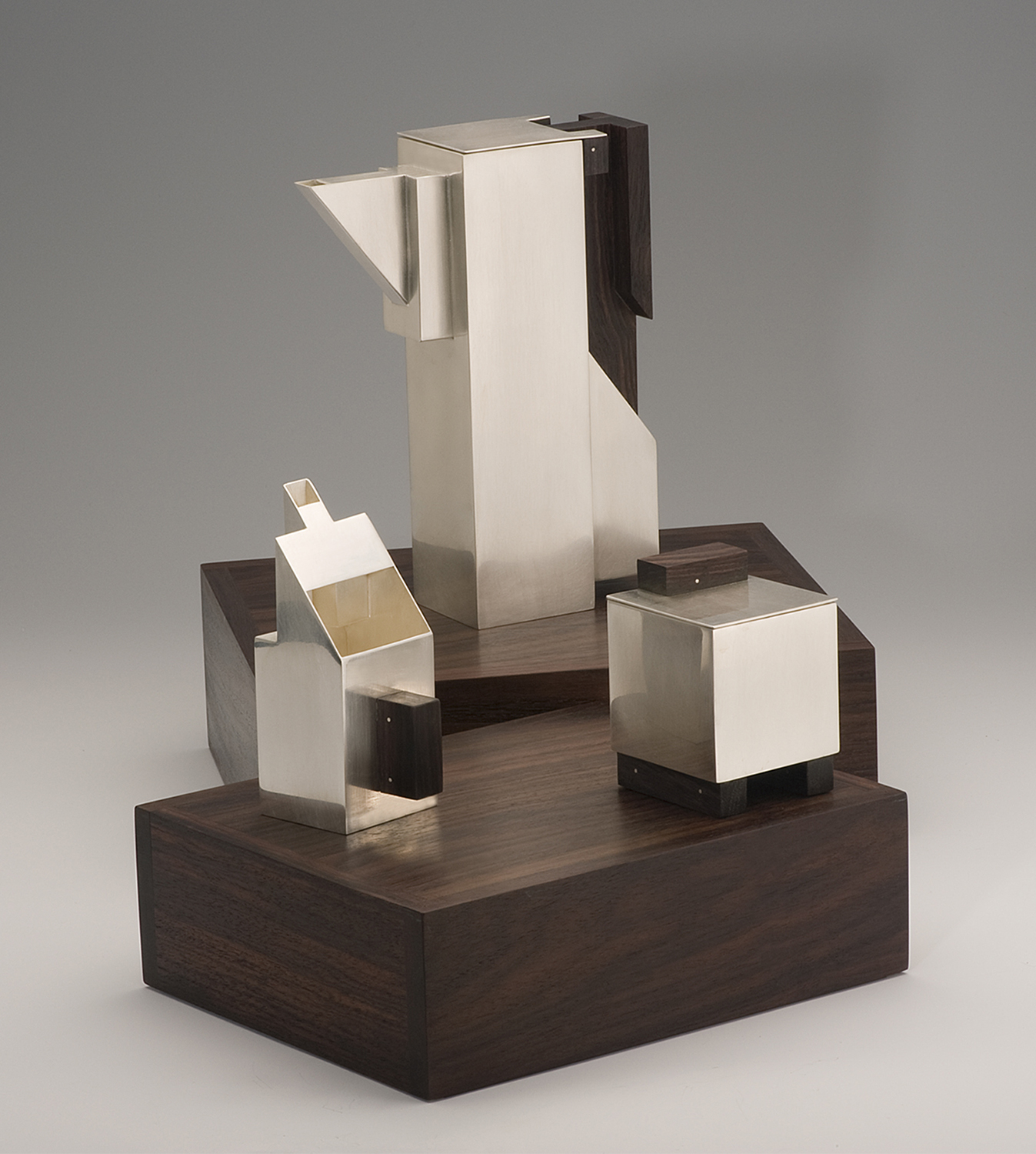 Puzzle Teaset-open  |  2010  |  sterling silver, rosewood  |  10.25 x 8.5 x 3.33 inches