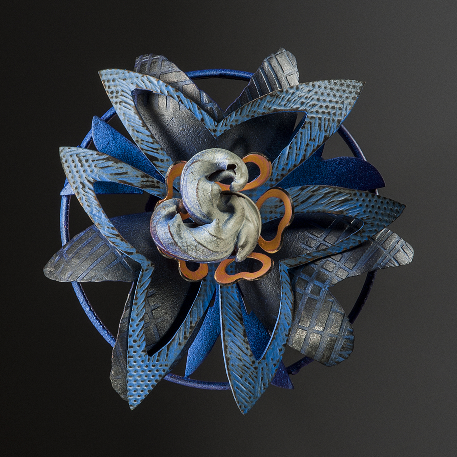 Rosette Brooch 4-14  |  2014  |  copper, brass, polymer  |  3.75 x 3.75 x 1.25 inches
