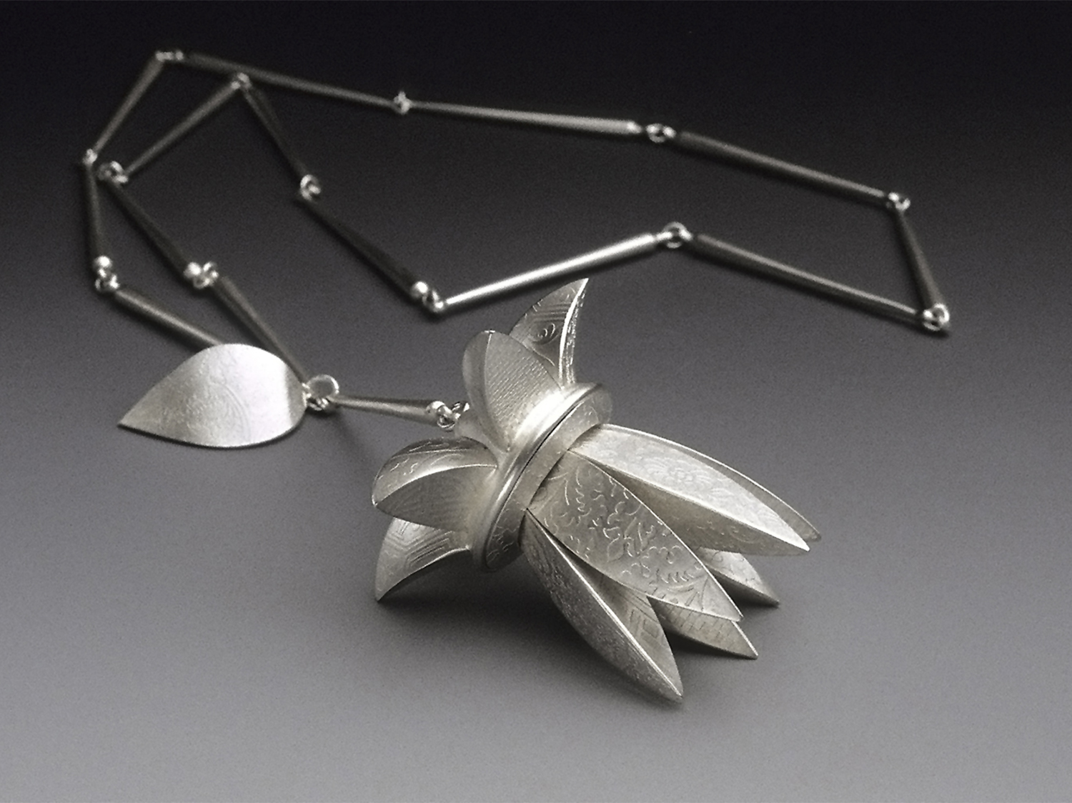 Flower Pendant  |  2000  |  sterling silver  |  3.125 x 2.675 x 2.675 inches