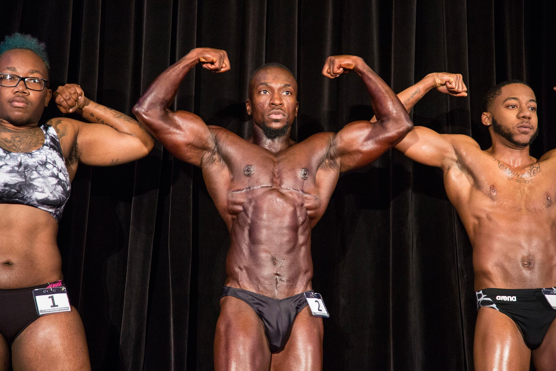 """SHAWN, 37 (Atlanta, GA)    Two-time winner of past Trans FitCons, Shawn now serves as a judge at this year's competition (a sudden serious illness knocked Shawn out of the running for a """"three-peat"""").But he's still known as the """"godfather"""" of trans male bodybuilding. [Secondary Subject]"""