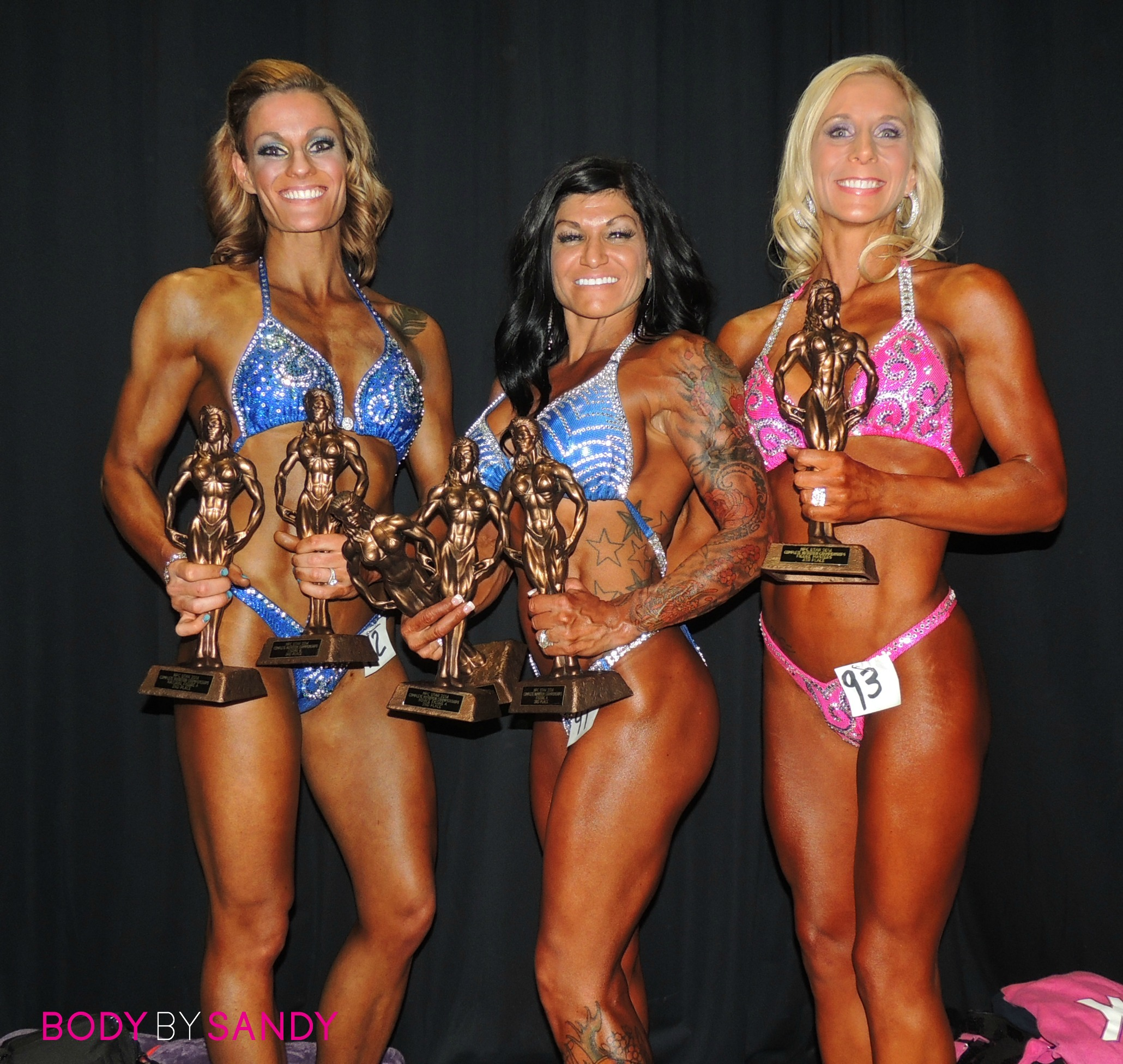 2014 NPC Complete Nutrition-Figure girls with trophies.JPG
