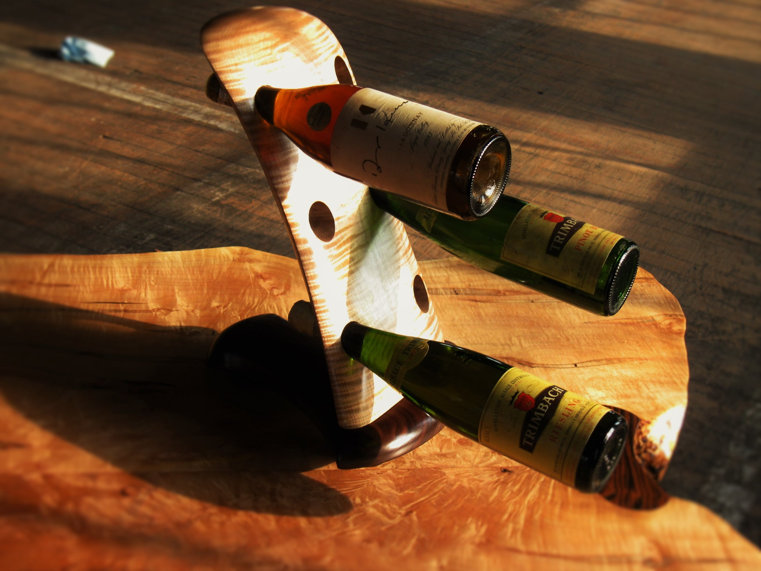 Dane's Wine Rack      Starting at $895     Shown in Figured Maple, Walnut, and Macassar Ebony