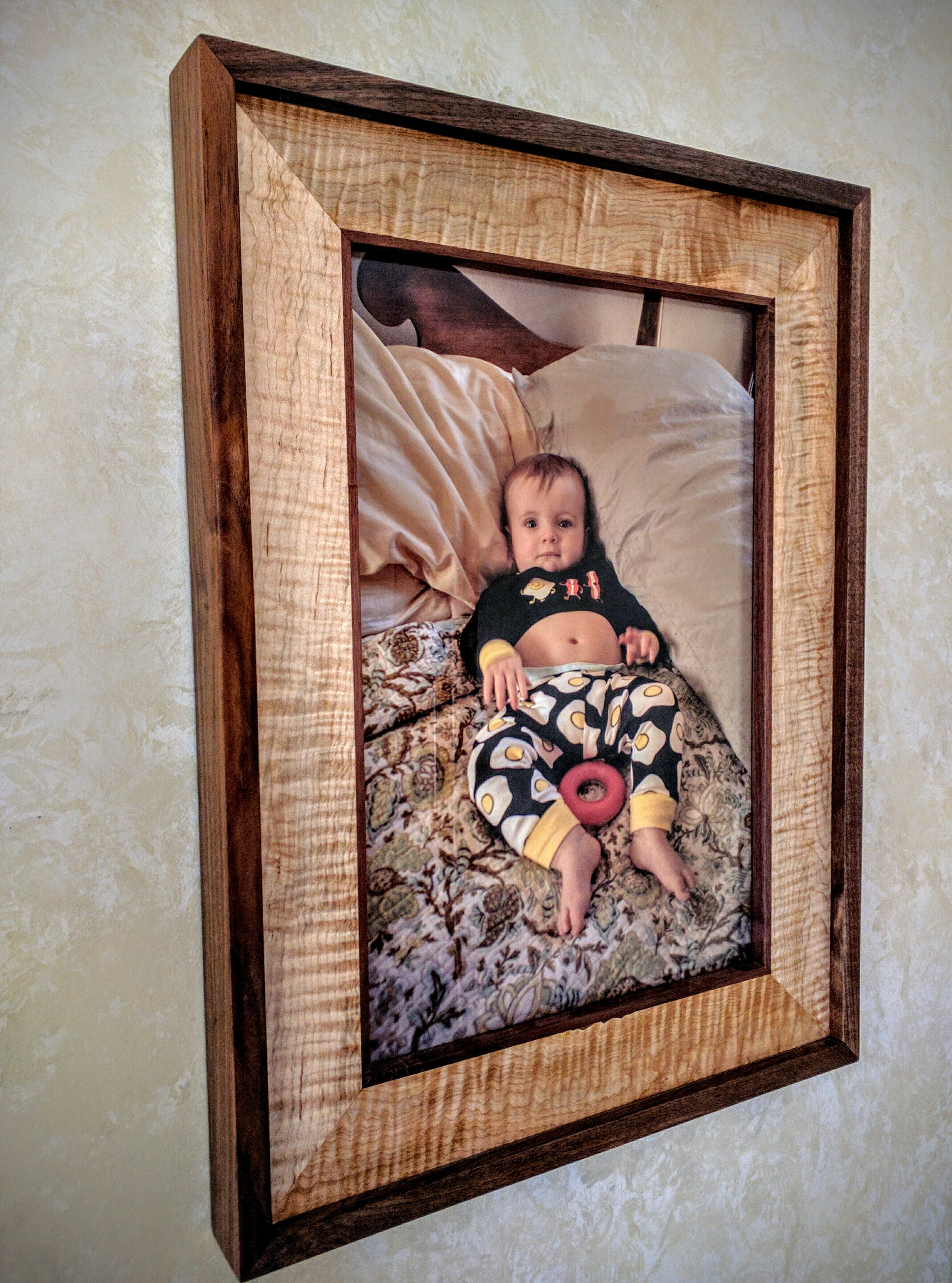 """Two-Tone Frame  $850  Shown in Walnut and Heavily Figured Maple  Fits 12""""x18"""" Photo."""
